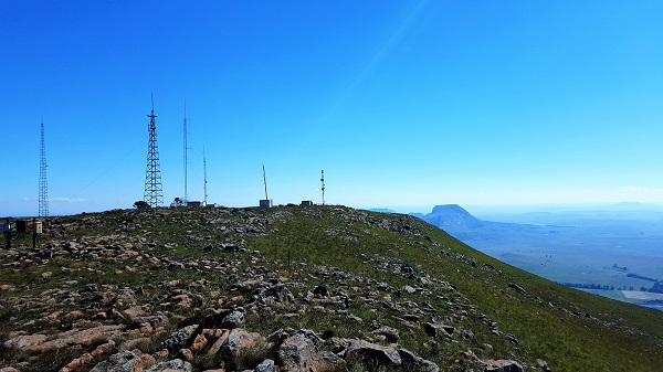 A forest of telecom towers at the summit