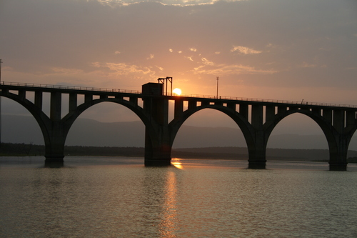 Sunset over the rail bridge over the Phongola River