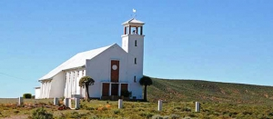 A church stands proudly on a small hill near Loeriesfontein