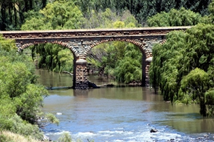 The arched stone bridge further upstream